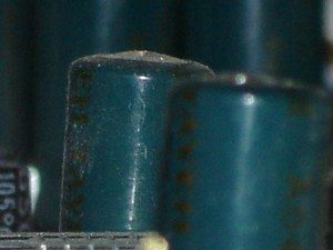 Domed top on a potentially failed capacitor